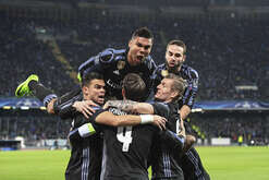Real Madrid players celebrated after Sergio Ramos first goal during the Champions League, soccer match between Napoli and Real Madrid at the San Paolo stadium in Naples, Italy, Tuesday March 7. Real Madrid won the match 3-1.