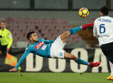 Napoli's French striker Adam Ounas makes a bicycle kick during the Italian TIM Italy Cup football match SSC Napoli vs Atalanta BC at the San Paolo Stadium. Atalanta won the match 2-1.