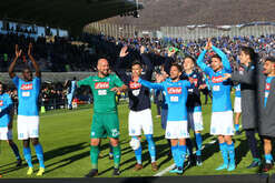 From left to right: Napoli's French defender Kalidou Koulibaly, Napoli's Spanish goalkeeper Pepe Reina, Napoli's Spanish striker Jose Maria Callejon, Napoli's Belgian striker Dries Mertens, Napoli's Polish midfielder Piotr Zielinski, Napoli's Italian midfielder Brazilian-born Jorginho,Napoli's Brazilian goalkeeper Rafael and Napoli's Italian striker Lorenzo Insigne celebrate at the end of the Italian Serie A football match Atalanta BC vs SSC Napoli at the Atleti Azzurri D'Italia Stadium. SSC Napoli won the match 1-0.