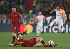 FC Shakhtar's Brazilian midfielder Bernard, (R) fights for the ball with Roma's Greek defender Kostas Manolas next to Roma's Italian midfielder Daniele De Rossi during the UEFA Champions League Round of 16 second leg football match AS Roma vs FC Shakhtar Donetsk  at the Olimpico Stadium. AS Roma won 1-0.