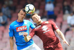 Torino's Italian striker Andrea Belotti (R) heads the ball as fighting with Napoli's Romanian defender Vlad Chiriches during the Italian Serie A football match SSC Napoli vs Torino FC at the San Paolo Stadium. The match ended 2-2.